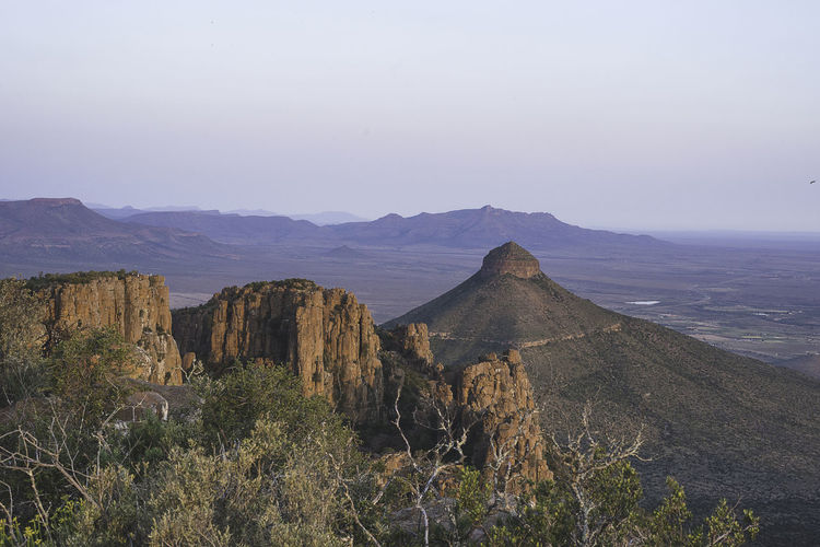 Scenic view of rocky mountains against sky at valley of desolation during sunset
