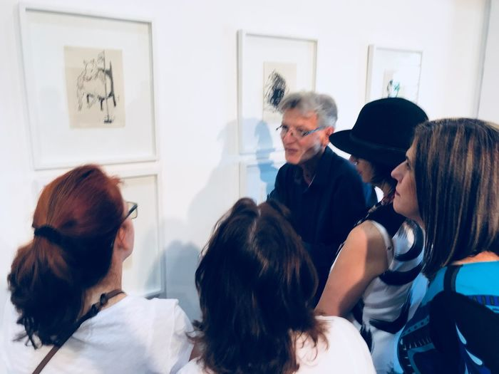 Groups of people at an art exhibition EyeEm Selects Group Of People Men Real People Indoors  Males  Women Adult People Lifestyles Senior Adult Communication Young Adult Casual Clothing Togetherness Females Young Women Business Person Business