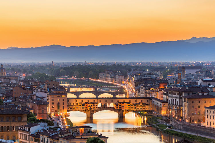 View of Florence at sunset with the Ponte Vecchio bridge over the Arno River Florence Itaky View Viewpoint Sunset Ponte Vecchio Bridge Arno  River Architecture Building Exterior Built Structure City Water Bridge - Man Made Structure Sky Travel Destinations Illuminated Cityscape High Angle View Dusk No People Outdoors Arch Bridge Skyline Dawn Cityscape City Light Old House Houses Landscape Aerial View Urban Urban Skyline Town TOWNSCAPE Scenery Scene Scenics Horizon Townhouse Townhouses Famous Place Evening Light Silhouette