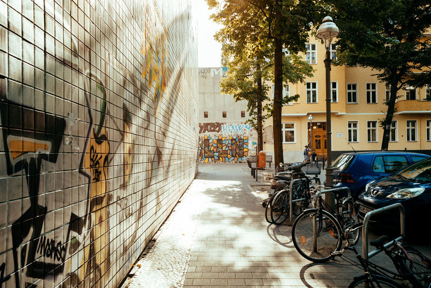 On a bright Saturday City Street Light Urban Exploration Urban Geometry Alley Architecture Berliner Ansichten Bicycle Building Building Exterior Built Structure City Day Light And Shadow No People Outdoors Plant Residential District Shadow Street Streetphotography Sunbeam Sunlight Tree Urban