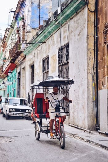 I call them sustainable taxis. Street City Mode Of Transport Bicycle Land Vehicle People Profession Lifestyles Working Everyday Lives Public Transportation Third World Country Transportation Daily Life Commute Daily Commute Real People Steetphotography Cuba Havana