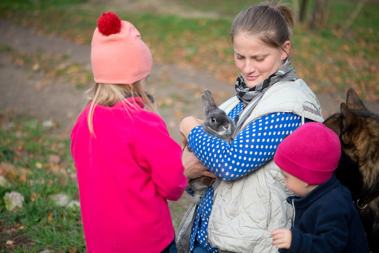 Childhood Child Females Togetherness Family Rabbit Gray Rabbit Easter Easter Holidays Easter Bunny Kid Pets Pet Domestic Pets Rural Lifestyle Rural Life Happiness Positive Emotion Warm Clothing Outside Dog
