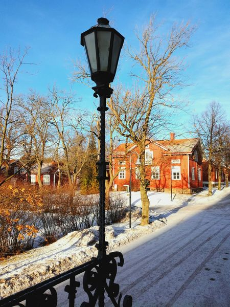 Old Lamp Building Exterior No People Architecture Built Structure House Outdoors Day Street Light Wintertime Architecture Wrought Iron Lantern Red Old Warm Color Old Places Kolmikulma Finland Sunny Day Old Buildings Decorative Trees Street Red House