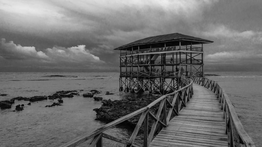 The Boardwalk - Siargao, Philippines Beach Beach Life Beauty In Nature Black And White Boardwalk Business Cloud - Sky Cloud Nine Holiday Iconic Landmark Lifestyle Nature Trip Outdoors Party Beach Rock Formation Scenic Landscapes Siargao Island Summer Destination Surfing Capital Surfing Capital GeneralLuna Surfing Paradise Tranquility Unspoiled Beach Vacation Destination The Great Outdoors - 2017 EyeEm Awards Neighborhood Map The Great Outdoors - 2017 EyeEm Awards Live For The Story Live For The Story BYOPaper! The Street Photographer - 2017 EyeEm Awards The Architect - 2017 EyeEm Awards EyeEmNewHere