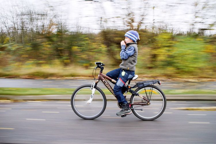 Woman riding bicycle on road