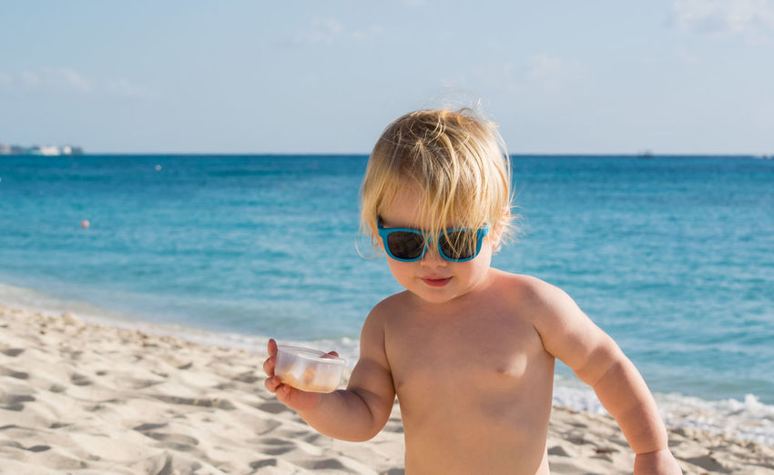Cute boy standing at beach