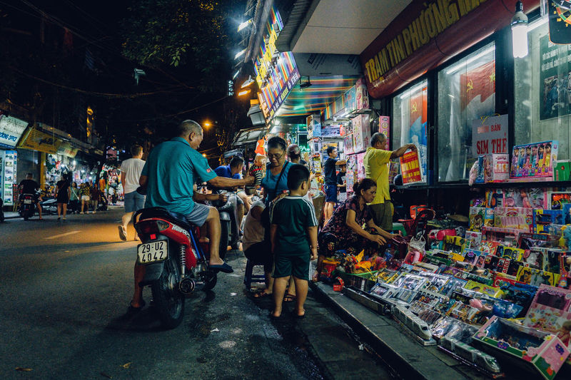People at street market in city at night