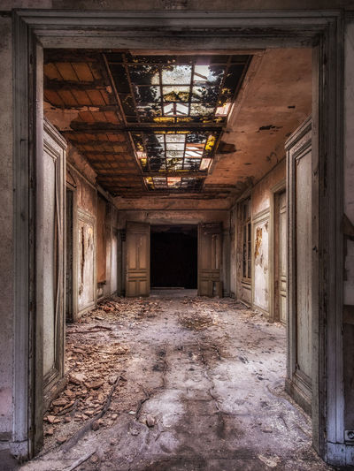 Beautiful decay in an abandoned villa. Urbex Urban Exploration Urban Exploring Abandoned Decay Decaying Abandoned Places Village Stairs Chiquesnourtemo Grandeur Chique Architecture Lost Places Dark Contrast No People Absence Built Structure Spooky Moody Sky Ghost Indoors  Building