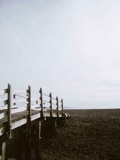 Beauty In Nature Day Horizon Over Land In A Row Majestic Nature No People Non-urban Scene Outdoors Protection Scenics Sea Seascape Sky Tourism Tranquil Scene Tranquility Travel Destinations Vacations Water Wood - Material Wooden Post