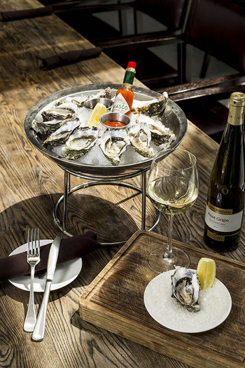 American American Food Drink Food Food And Drink Lemon Oyster  Oysters Restaurant Seafood Seafood Platter Tabasco Table White White Wine Wine Wineglass