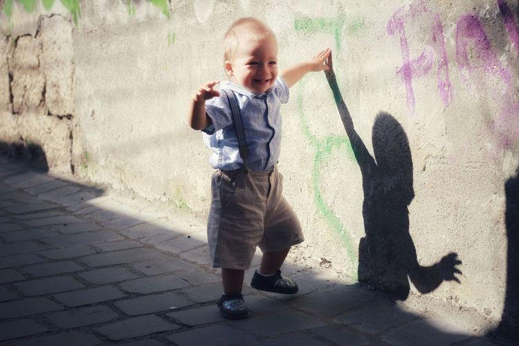Full length of boy standing on street