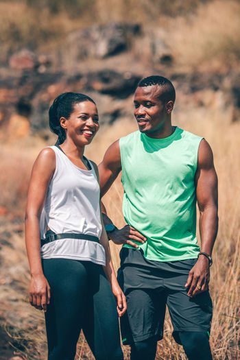 Couple standing on mountain