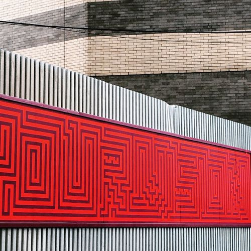 Red maze pattern on wall
