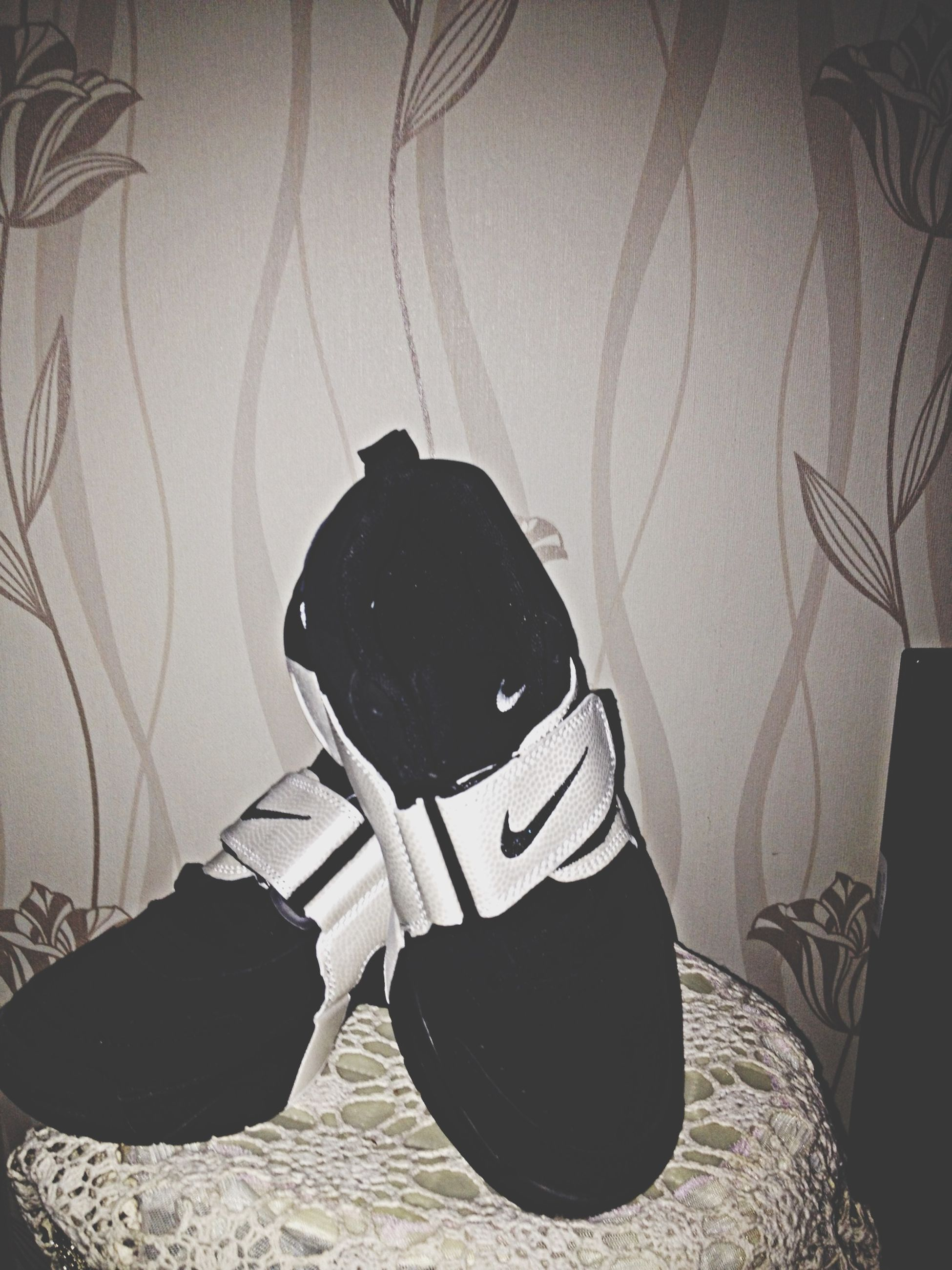 indoors, still life, wall - building feature, table, creativity, art and craft, home interior, art, high angle view, close-up, shadow, no people, black color, decoration, chair, wall, paper, hanging, shoe, fashion