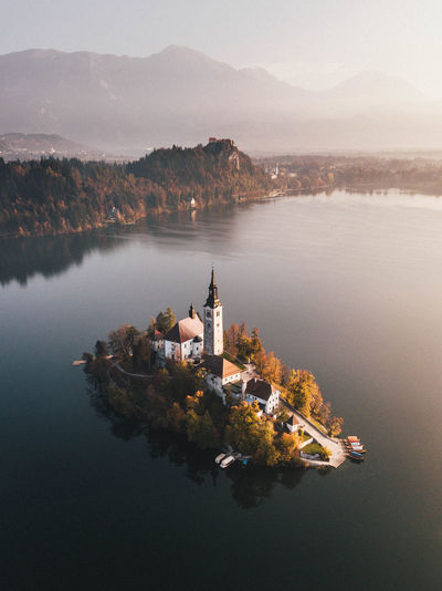 High Angle View Of Church By Lake During Sunset