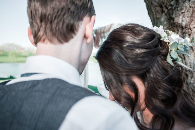 Rear view of couple kissing