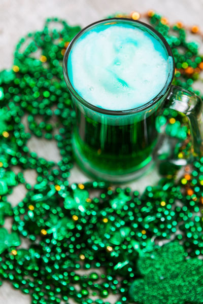 St. Patrick's Day series with lots of copyspace around beads, green beer and pots of gold. Beer Green Green Beer For St Patrick's Day Holiday Saint Patrick's Day St. Patrick's Day St. Patricks Day St. Pattys Day Wood Background Green Beer Irish No People Poster Background