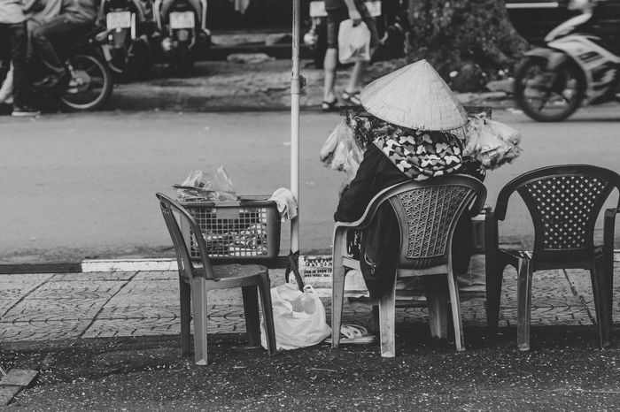 Big City Big City Life Blackandwhite Chair Day Ho Chi Minh City One Person Outdoors People Saigon Sitting Street Streetphoto_bw Streetphotography Streetsale Vietnam Vietnamese Woman