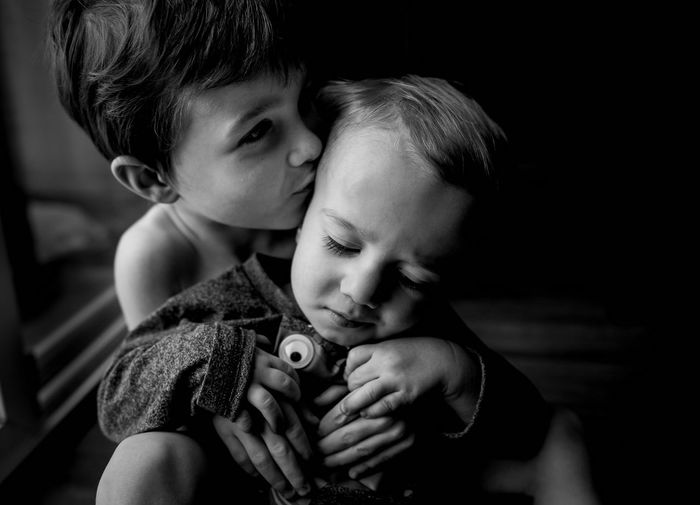 Two People Love Child Baby Embracing Cute Consoling Bonding Lifestyles Headshot Small Childhood Holding Togetherness Males  Domestic Life Monochrome Cheerful Care Brothers Boys Children Hugging