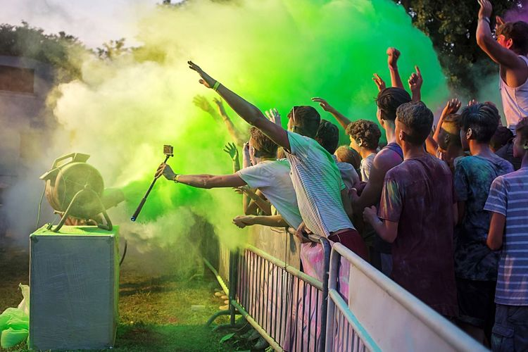 People enjoying with colors during festival