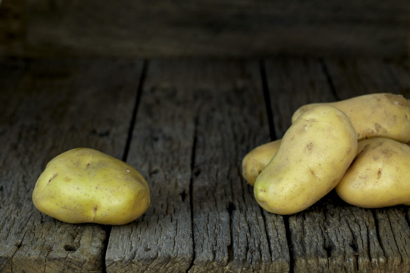 Potato Wooden Fresh Potatoes Background Table Old Food Raw Nutrition Wood Harvest Healthy Vegetable Organic Agriculture Rustic Brown Pile Ingredient Root Vegetarian Natural Farm Top View Group Heap Sack Diet Produce Many Yellow Cooking Dark Rural Uncooked Burlap Tuber Dirty Food And Drink Healthy Eating Wood - Material Freshness Wellbeing Close-up Still Life No People Fruit Group Of Objects Raw Food High Angle View Indoors  Day Green Color