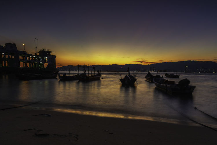 Majestic sunset scenery of the sunset taken at Penang Sentral with a view of ferry transportation, Penang, Malaysia. Sky Nautical Vessel Water Transportation Sunset Mode Of Transportation Illuminated Nature No People Sea Reflection Orange Color Night Silhouette Scenics - Nature Architecture Building Exterior Beauty In Nature Outdoors Penang Nature EyeEm Best Shots Landscape Malaysia Travel Destinations
