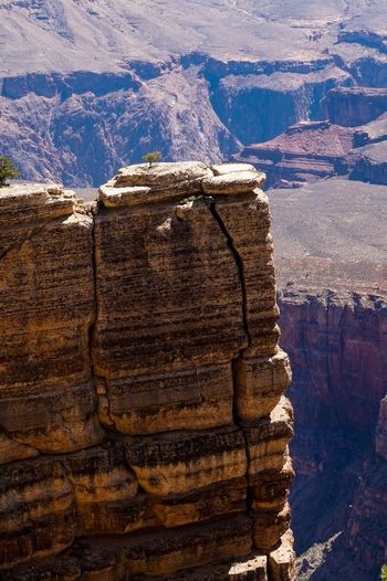 Scenic View Of Cliff By Rocky Mountains At Grand Canyon