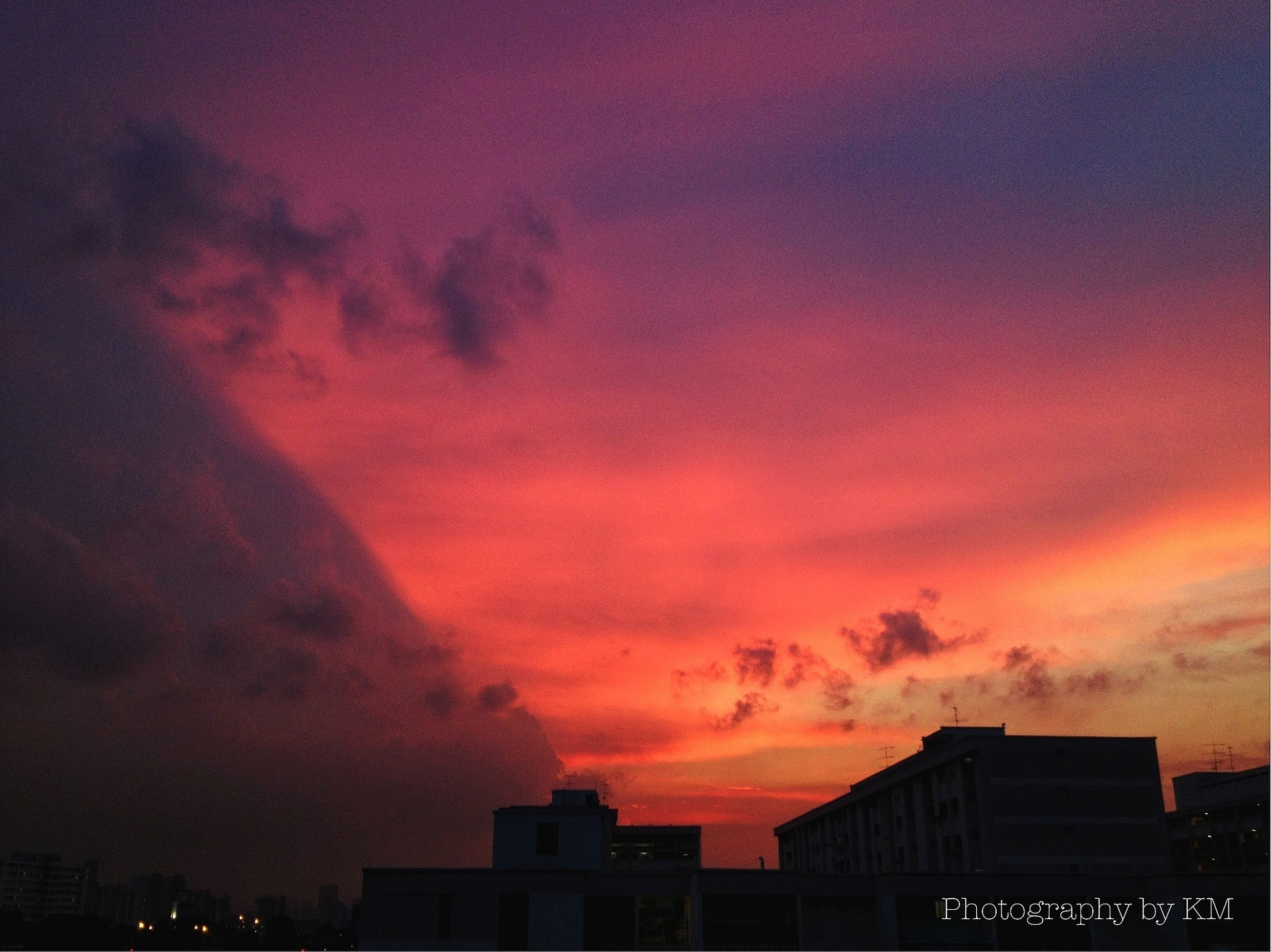 sunset, architecture, building exterior, sky, built structure, orange color, silhouette, cloud - sky, dramatic sky, low angle view, beauty in nature, cloudy, city, scenics, cloud, nature, weather, residential building, overcast, residential structure