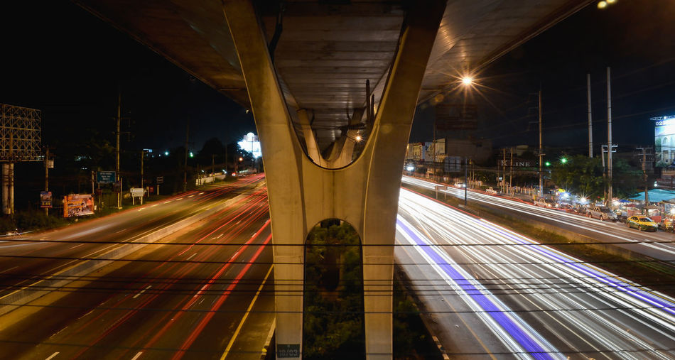 Architecture Bridge - Man Made Structure Built Structure City Illuminated Mode Of Transport Night No People Outdoors Public Transportation Rail Transportation Railroad Station Railroad Station Platform Railroad Track Speed Transportation