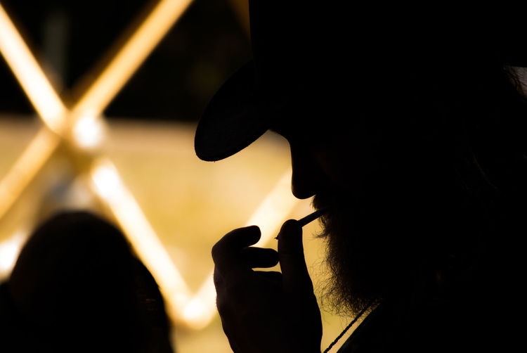 Contemplation First Eyeem Photo Man Smoking Resting Resting In Shade Shade Silhouette Silhouette Collection Smoke Smoking Timeout