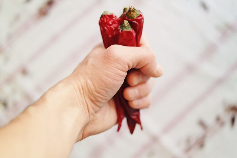 Hot temper... Human Hand Human Body Part Red Holding Close-up Freshness Details Of My Life Found On The Roll My Favorite Photo Made In Romania Fresh On Eyeem  Vscocam Chilli Peppers Kitchen Cooking Natural Light Food Spicy Food Hot Tasty Vegetables Ingredients Spicyfood Fist Food Stories