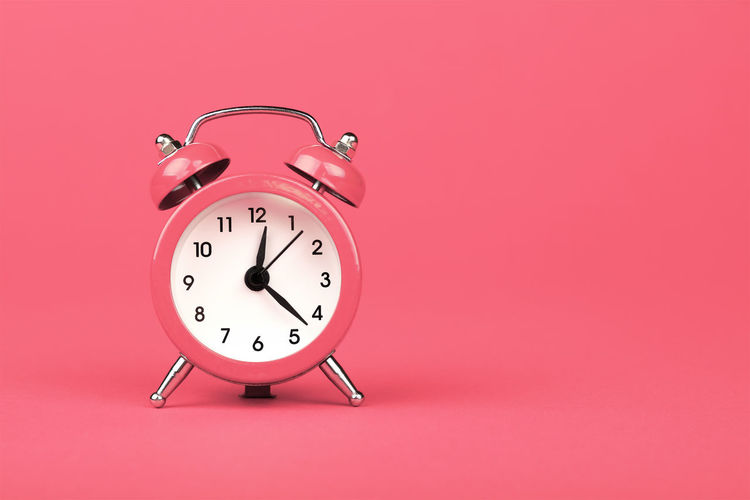 Pink alarm clock over living coral paper background Clock Time Alarm Clock Studio Shot Colored Background Copy Space Single Object Retro Styled Number Minute Hand Pink Background Clock Face Checking The Time Instrument Of Time Close-up Living Coral Color Of The Year 2019 Pink Dead Line Lunch Time! Round Pink Color Deadline Old-fashioned Old 17.62°