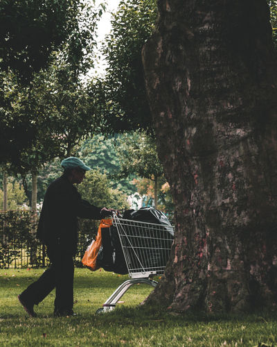 Man by tree in park