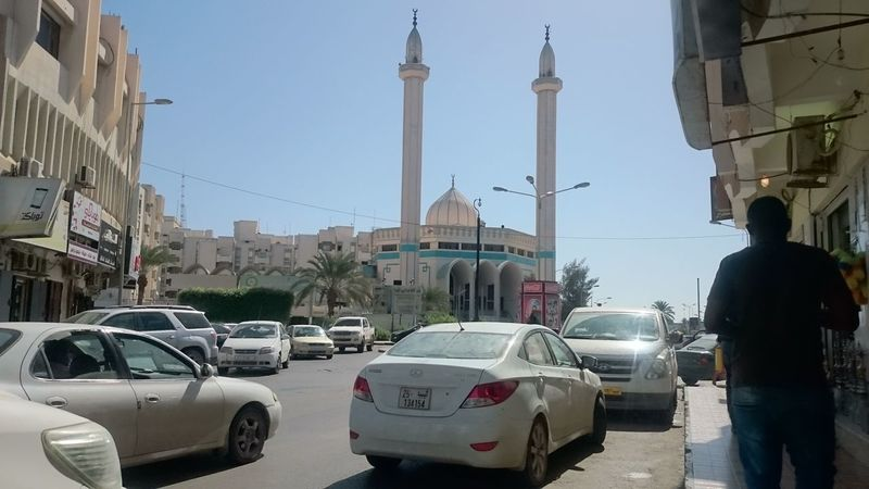 Misrata Architecture Building Exterior Built Structure Car City Day Land Vehicle Men Mişrātah Mode Of Transport Outdoors People Real People Road Sky Stationary Street Transportation
