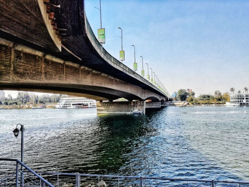Water Architecture Bridge - Man Made Structure Built Structure EyeEmNewHere Transportation Outdoors Day No People Nature Sky The City Light EyeEmBestPics EyeEm Gallery The Week On EyeEem EyeEm Best Shots EyeEm Best Edits Team EyeEm Beauty In Nature Feature Theme Background Featured Low Angle View City Egypt,Nile River,Tahrir The Architect - 2017 EyeEm Awards