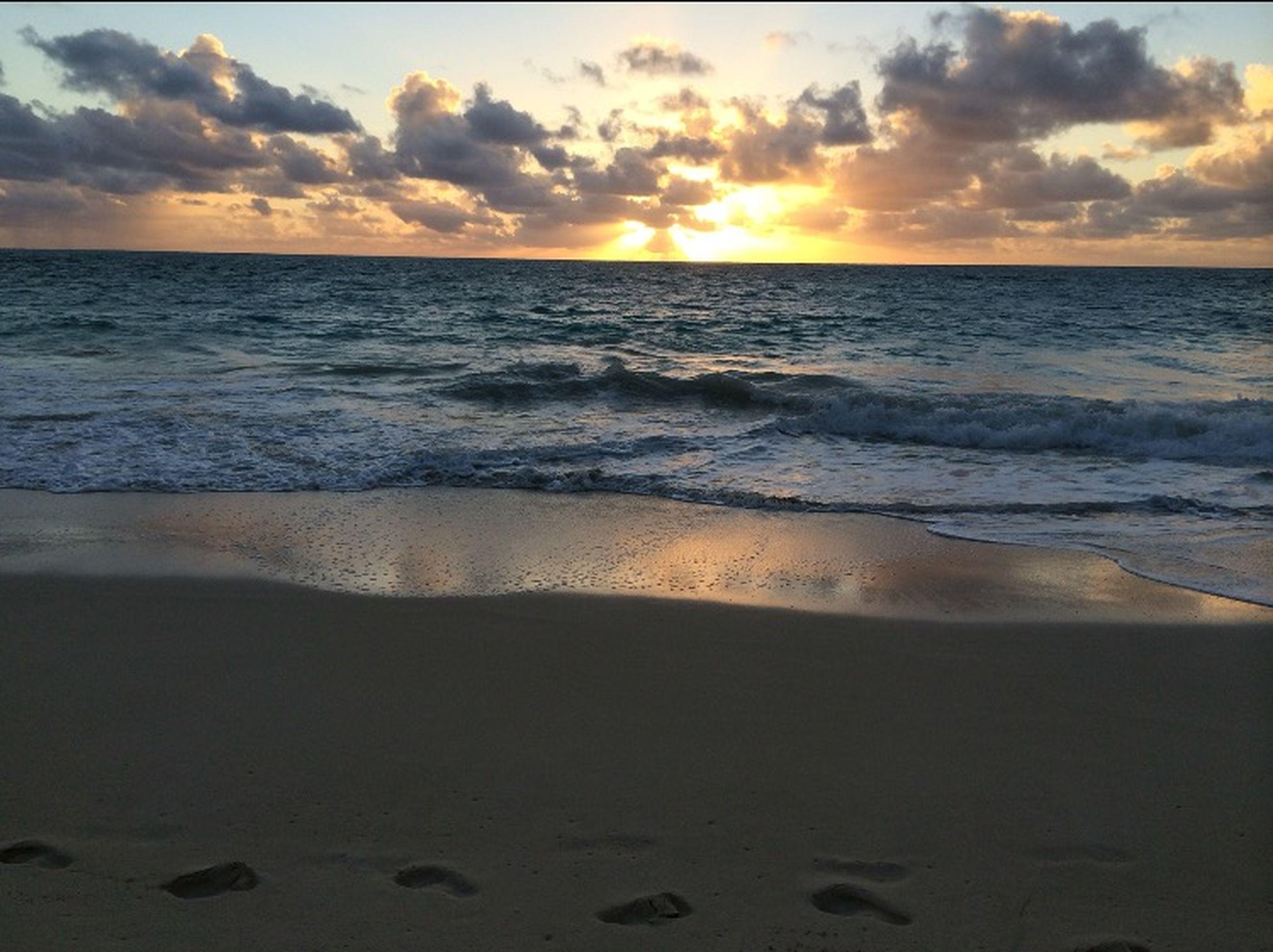 sea, horizon over water, beach, water, shore, scenics, sunset, sky, beauty in nature, tranquil scene, tranquility, wave, sand, idyllic, nature, cloud - sky, surf, cloud, seascape, coastline