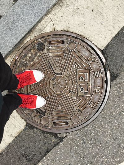 Real People One Person High Angle View Manhole  Low Section Shoe Leisure Activity Footpath Human Leg Personal Perspective Lifestyles Pattern Standing Outdoors Men Day Human Body Part Human Hand One Man Only Puma Travel Seoul South Korea EyeEmNewHere