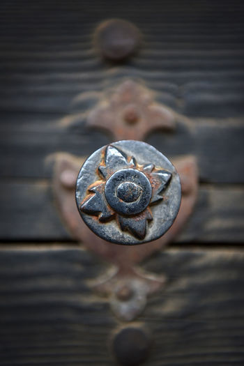 Close-Up Of Metal On Wooden Door