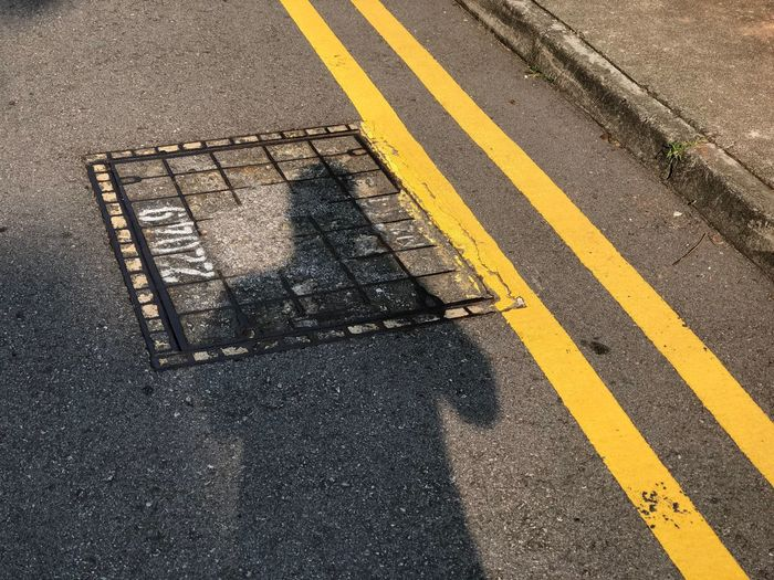 High angle view of shadow  on road