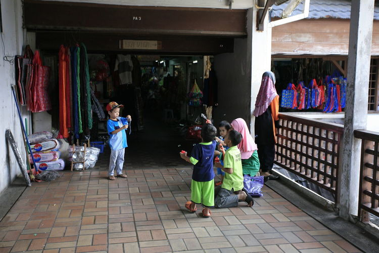 Children playing each other at Pasar Payang, Terengganu, Malaysia Children Casual Clothing Childhood Choice Clothing Clothing Store Day Fashion Full Length Indoors  Kid Leisure Activity Lifestyles Play Real People Retail  Standing Store Variation