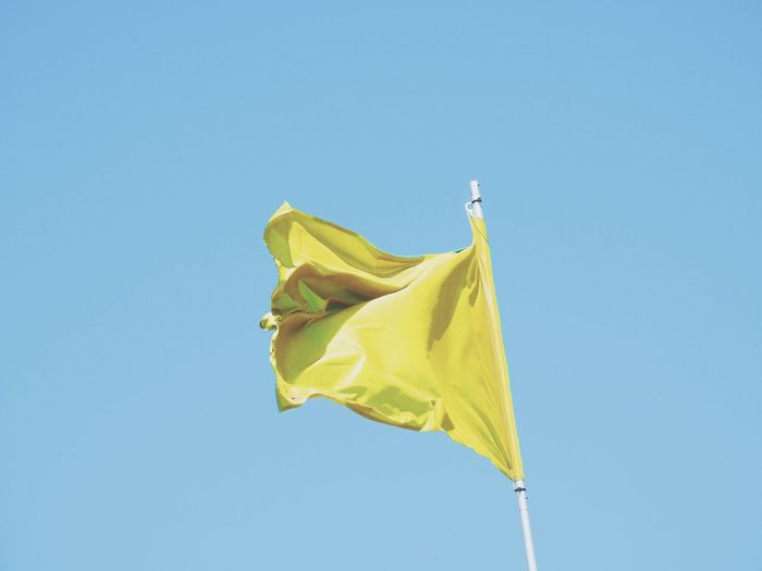 Paint The Town Yellow Flag Blue Wind Hanging Outdoors Yellow Low Angle View Sky Day Clear Sky No People Flags Yellow Flag Landscape Beach Yellow Color Yellow Colour Yellow Collection Yellow Colours