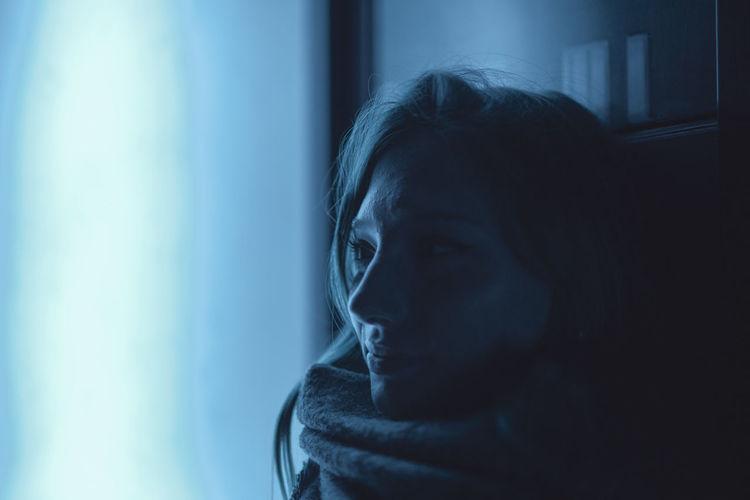 Close-up of smiling woman at night