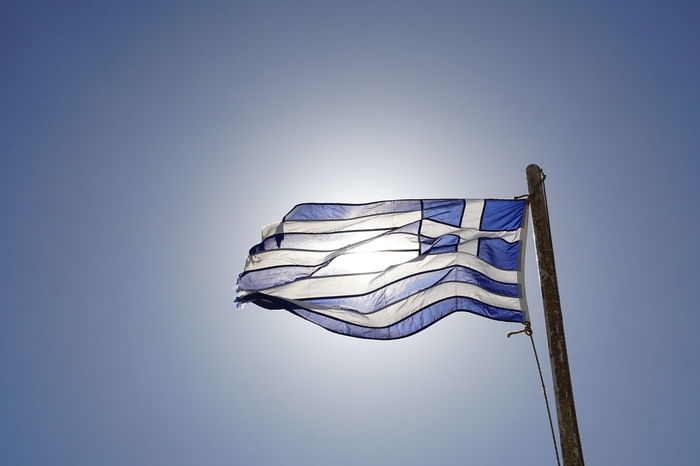 Greece! Blue Color Greek Nationalism Patriotic Patriotism Silhouette Sunlight White Clouds Blue Sky Clear Sky Cloudless Day Flag Flagpole Greece Greek Flag Low Angle View Nationality Patriotism Pride Striped Sun Translucent Wind Windy