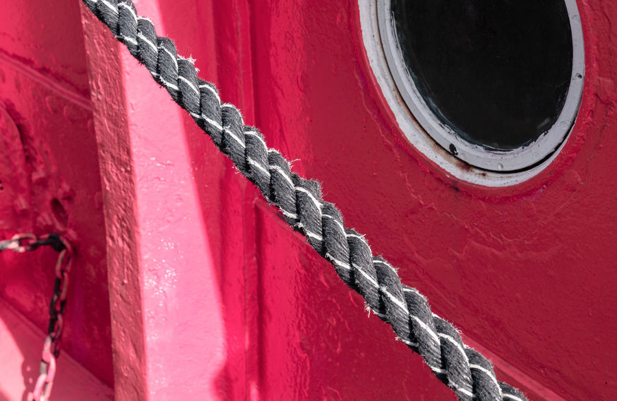 Selected For Premium Rope Premium Collection The EyeEm Collection Bullseye Porthole Harbor Harbour Pier Close-up Day Focus On Foreground Full Frame Metal Mode Of Transportation Nautical Vessel No People Outdoors Pattern Red Ship Shipping  Strength Textured  Transportation Window Red Textured  Transportation