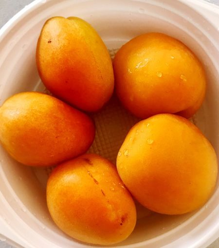 High angle view of oranges in bowl