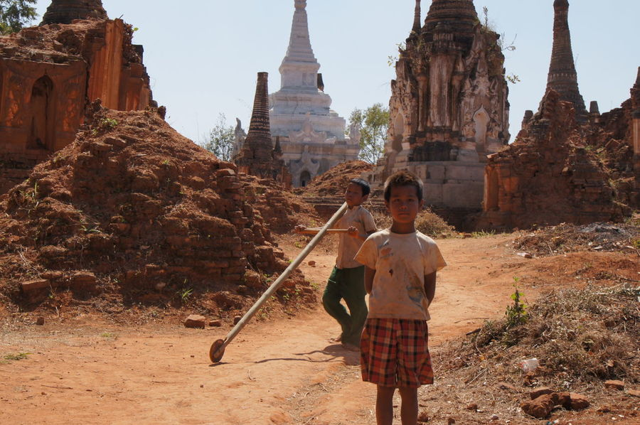 Kids with self made toy, Off the beaten track, in and around Taunggy, Shan State, Myanmar Shan State Adult Adults Only Ancient Ancient Civilization Architecture Building Exterior Built Structure Day History Myanmar Old Ruin Outdoors People Place Of Worship Real People Religion Sky Smiling Standing Tourism Travel Travel Destinations Women