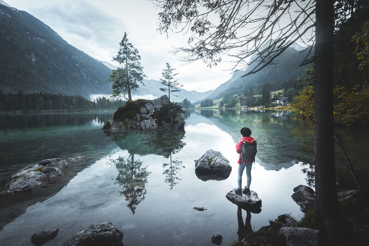 Water Real People One Person Tree Reflection Plant Lake Nature Rear View Leisure Activity Beauty In Nature Lifestyles Mountain Full Length Scenics - Nature Men Tranquility Day Outdoors Hintersee Hiking Reflection Moody Hiker Rock