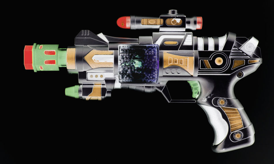 retro ray gun Plastic Gun Ray Gun Retro SiFi Toys Black Background Close-up Copy Space Gun Handgun Indoors  Isolated On Black No People Studio Shot Technology Toy Gun Transparent Weapon