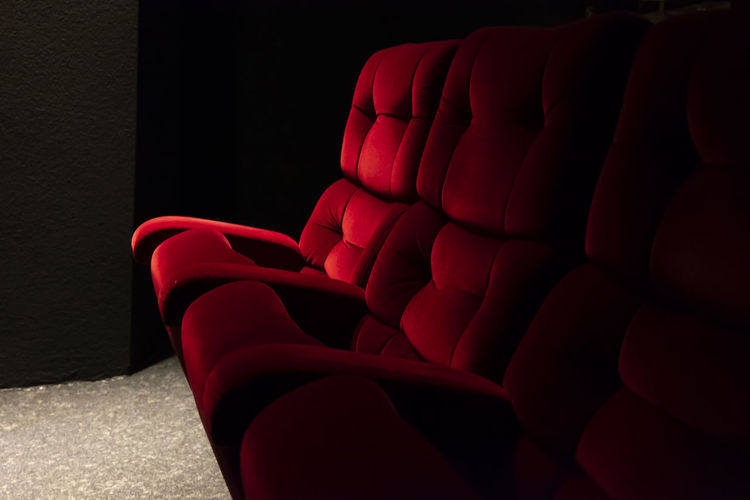 Cinema Chairs. Art And Craft Chair Classic Creativity Film Festival In A Row Part Of Theater Armchair Art Arts Culture And Entertainment Chairs Cinema Close Up Color Film Industry Furniture Illuminated Indoors  No People Red Color Seat Side By Side