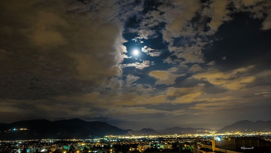 Sky Night Cloud - Sky Mountain Beauty In Nature Scenics Nature Outdoors No People Illuminated Tranquility Building Exterior Sunset Mountain Range Built Structure Moon Architecture Light